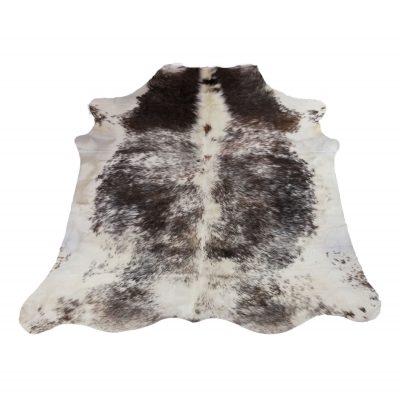 Brown white black cow rug