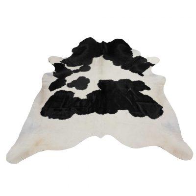 cow rug white black